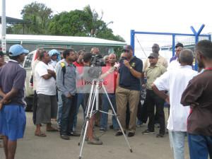 residents listen as Comrade Roget speaks IMG_8123