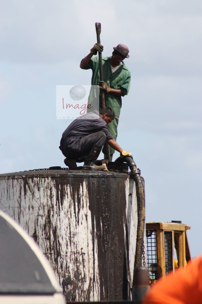 workers ontop of a tank IMG_8438